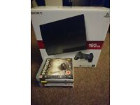 Boxed slim 160gb PS3 console with 2 controllers and 6 games.