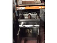 Fridge, oven, cooker, double fryers, hotplate, prep table with can opener