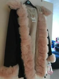 Faux fur woman's hooded parka
