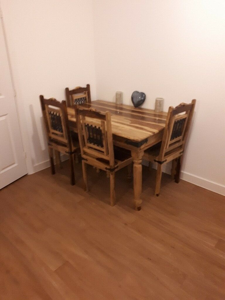 Dining table and matching chairs for sale.