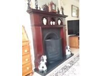 Mahogony fire surround,black marble hearth,cast iron insert,real flame gas fire.