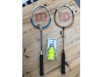 2 badminton racquets and shuttlecocks