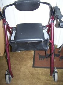 Four wheel rollator with bag. .