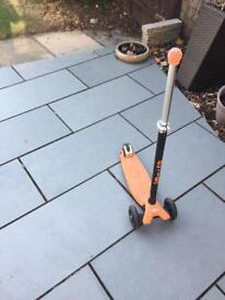 Orange and black maxi micro scooter