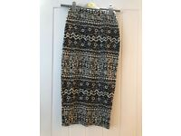 Black and cream patterned skirt