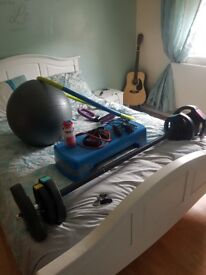 Weight bar and little bits of exercise equipment