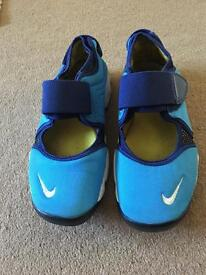 Boys size 4.5 Nike rifts