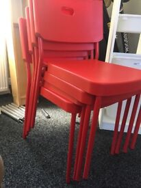 Red plastic stackable chairs x 4 £20