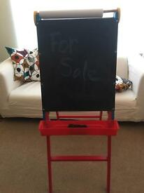 Easel with chalk and dry erase boards and a slot to hold paper for drawing and painting.