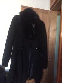 Stunning black ladies coat with fur collar