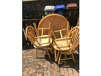 Circular wooden table with 4 chairs