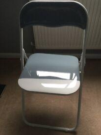 Grey/white plastic chair