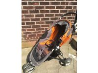 Baby Jogger City mini pushchair with footmuff, shopping bag handle and rain cover.