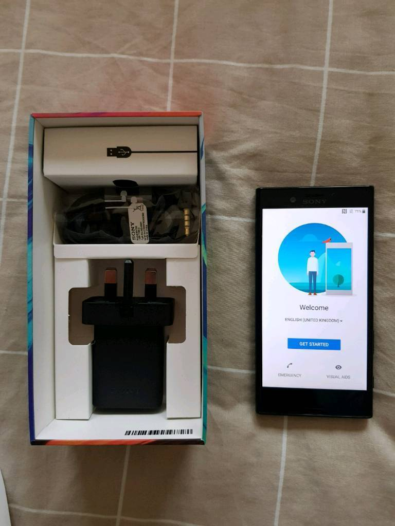 Xperia X compact black, unlocked, box and accessories and case. Like new.