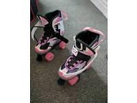 Size 1-3 Pink roller skates