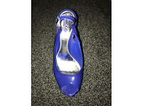 Authentic Gucci blue wedges in size 39