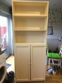 White ikea shelving unit, with cupboard at the bottom.