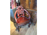 Oriental carved armchair , reproduction . Lovely carved detail.