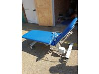 Medical treatment couch-two section