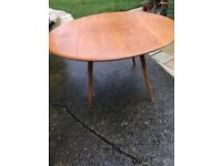 Vintage 1960s Round drop leaf Beech and Elm Ercol dining table