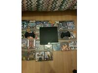 PS3 WITH 25 GAMES & 2 CONTROLLERS