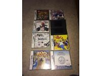 Black Nintendo ds lite and ganes
