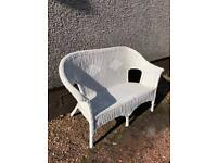 White wicker settee.