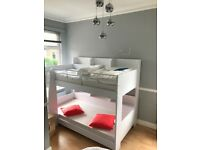 White bunk beds with built in shelving (super condition)