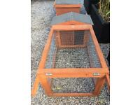 Rabbit hutch and run as new condition. Can deliver locally.