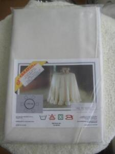 2 ROUND TABLE CLOTHS...NEVER USED...STILL IN ORIGINAL WRAPPER [ BOTH 70 in. ROUND]