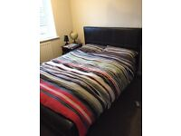 Double bed with Black leather frame with mattress for sale.