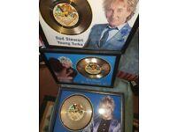 Framed Rod Stewart gold discs