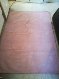 2 woven cotton rugs.