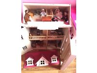 Pink wooden dolls house