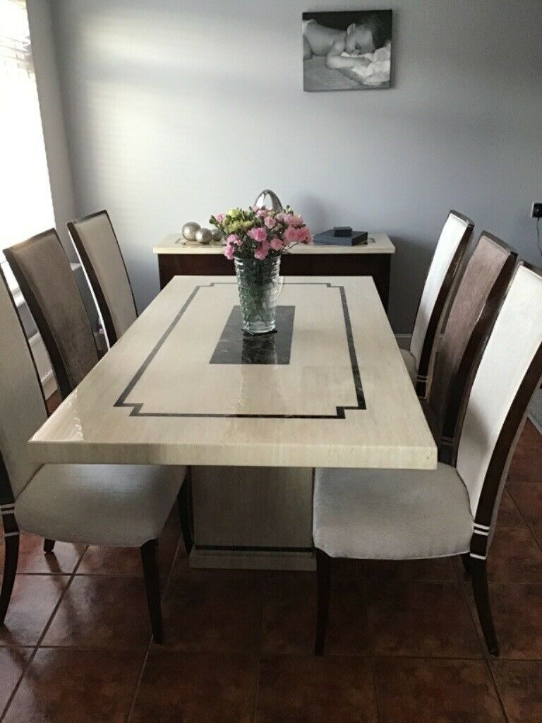 Solid marble dining table ,6 chairs plus matching marble ...