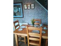 Stunning Solid wood oak no veneer table and four chairs can seat six