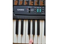 Casio CTK-520L electric keyboard, light up keys, new in box with instruction manual
