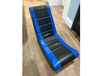 X-rocker gaming chair, blue and black leather, folds down for easy storage.