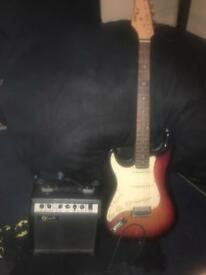 Left handed electric guitar, amplifier and lead