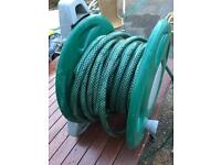 Wall mounted hose and reel
