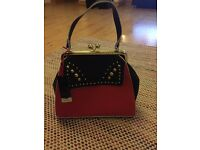 Ladies red and black handbag