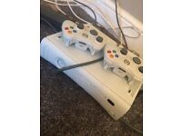 Selling my very good condition Xbox 360 with 2 controllers and games