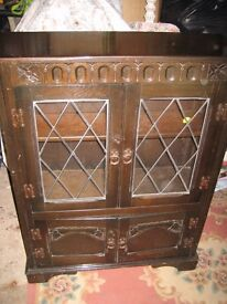 Wooden cupboard/bookcase/storage unit. Leaded glass doors.Ideal upcycle project or use as it is.