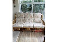 Conservatory furniture comprising a sofa and two arm chairs.