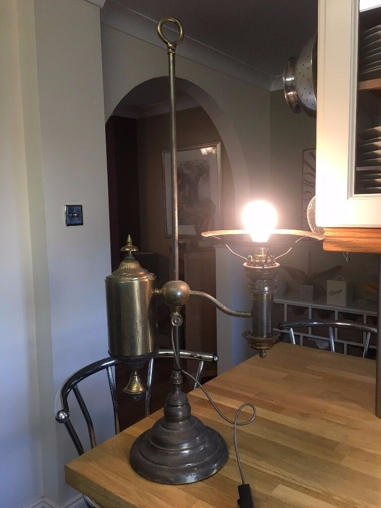 Old fashioned brass lantern with single bulb