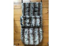 Buggy snuggle in gorgeous fur fabric.