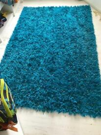 Large electric blue fluffy rug