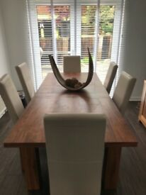 Extended dining table with 6 chairs and matching sideboard in walnut.