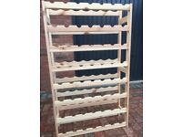 Wine rack in pine holds 56 bottles