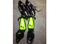 Adidas football boots (size 4.5) with Puma shin pads